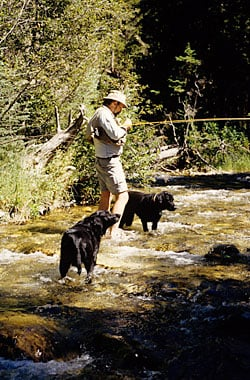 The author fishing with his dogs.