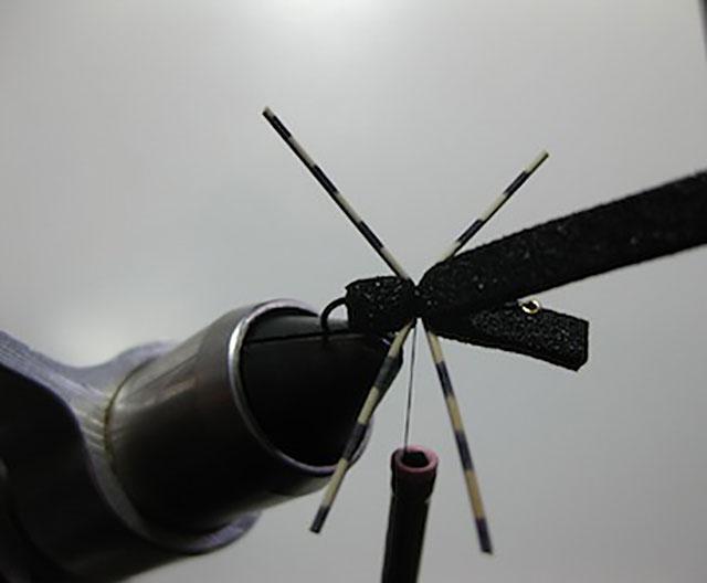 Tie in rubber legs on each side as shown, size medium.
