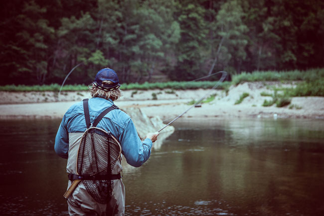 Igor Glinda of Poland's Lower Silesia works a fish on the Upper Bobr River.